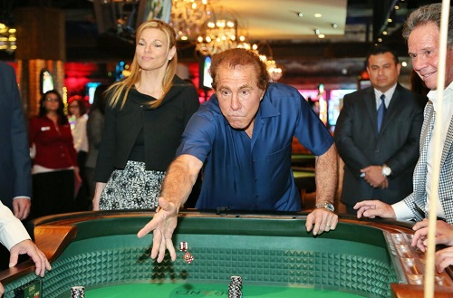 Steve Wynn makes the first roll at the craps table at Downtown Grand