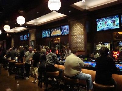 Patrons playing video poker at O'Sheas bar
