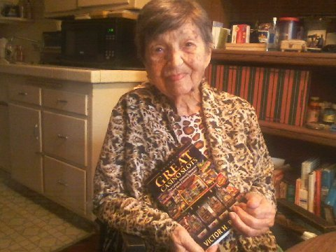 Gina, Victor Royer's mother, holds her son's book 'Great Casino Slots'