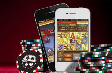 Mobile phones displaying online casinos with poker chips