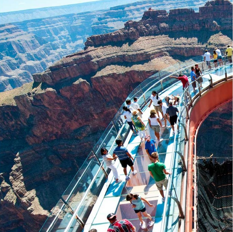 People view the grand canyon on the Skywalk on the Canyon Celebration Sky High Fun Tour